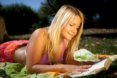 Reading in the sun Royalty Free Stock Images