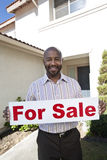 Real Estate Agent Holding 'For Sale' Sign Royalty Free Stock Photos