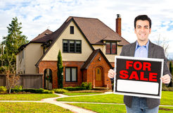 Real estate agent standing outside house Royalty Free Stock Image