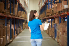 Rear View Of Female Worker In Distribution Warehouse Stock Image