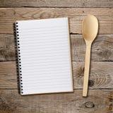 Recipe book and spoon Stock Photo