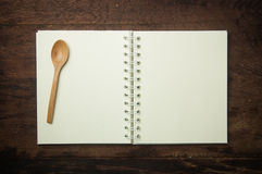 Recipe book and spoon Royalty Free Stock Photos