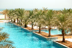 Recreation area of luxury hotel and swimming pool Royalty Free Stock Photography