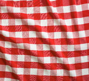 Red crumpled linen gingham picnic tablecloth Stock Image