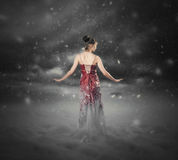 Red dress snow storm. Royalty Free Stock Photography