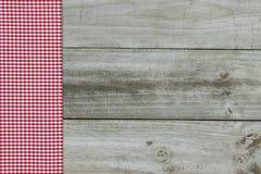 Red gingham border on wood background Stock Image