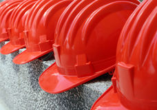 Red hard hats Stock Images