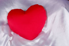 Red heart shaped pillow Stock Photography