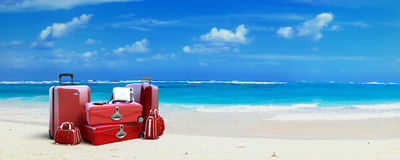 Red Luggage at the beach Stock Photography
