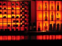 Red nightclub bar glowing bottles background Stock Image