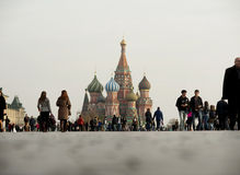 The Red Square and the Kremlin with plenty of tourists Stock Image