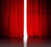 Red theater or cinema curtain slightly open and white light Royalty Free Stock Photography
