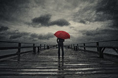 Red umbrella in storm Stock Photography
