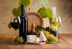 Red wine with cheese and white grape snack Stock Photo