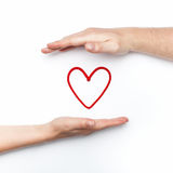 Relationship photo with two hands with red heart Stock Image
