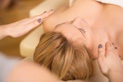 Relaxing during reiki healing Royalty Free Stock Photo