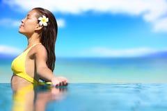 Relaxing serene woman at travel spa resort pool Royalty Free Stock Images