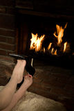 Removing shoes by fire Royalty Free Stock Images