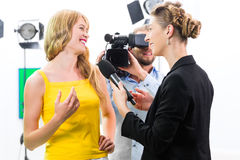 Reporter and cameraman shoot an interview Royalty Free Stock Image