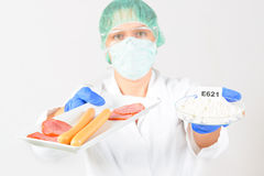 Researcher with food and preservatives Royalty Free Stock Images