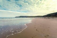 Retro Beach with footprints Scene Cayton Bay Stock Photography
