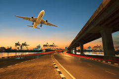 Road ,land bridge run into ship port and commercial cargo plane Royalty Free Stock Photography