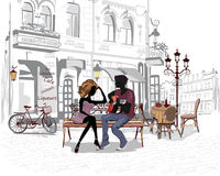 Romantic couple with a guitar sitting on the bench in the old city Royalty Free Stock Photography