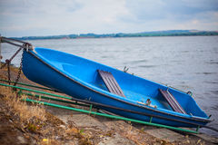 Romantic old boat on shore Royalty Free Stock Photography