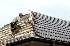 Roofer laying tiles Royalty Free Stock Photo