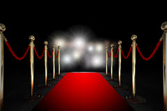 Rope barrier with red carpet and flash light Stock Image