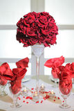 Roses arrangement and glasses Royalty Free Stock Images
