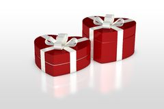 Rote Geschenkbox in der Herzform Stockbilder