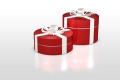 Rote runde Geschenkbox mit weißem Band Stockfotos