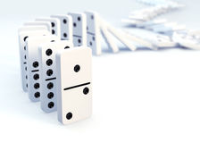 Row of dominoes collapsing Royalty Free Stock Photo