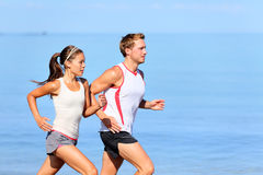 Running couple jogging on beach Royalty Free Stock Images