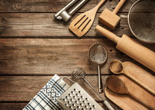 Rural kitchen utensils on vintage planked wood table Stock Photography
