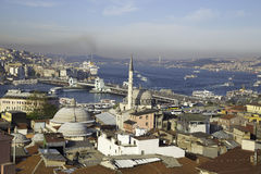 Rustem Pasa mosque with Galata and Bosphorus bridge near Golden Horn Royalty Free Stock Image