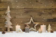 Rustic country background - wood - with candles and snowflakes f Royalty Free Stock Images