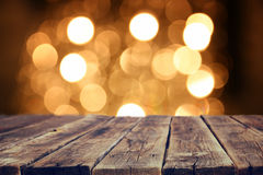 Rustic wood table in front of glitter gold bright bokeh lights Stock Images