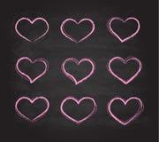 Símbolos retros do coração do vetor do giz do grunge do garrancho Fotos de Stock Royalty Free