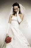 Sad bride with bunch of roses Royalty Free Stock Photography