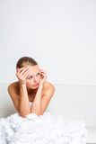 Sad bride crying sitting on a sofa Royalty Free Stock Images