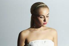Sad bride in white dress. Beautiful blond woman Royalty Free Stock Photo