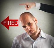 Sad fired businessman Stock Image