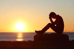 Sad man silhouette worried on the beach Royalty Free Stock Photo