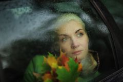 Sad woman in car Stock Photography