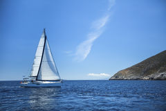 Sailboat in the calm sea. Sailing. Luxury yachts. Travel. Royalty Free Stock Photography