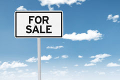 For sale sign under clear sky Stock Photos