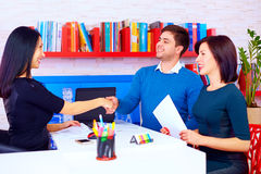 Satisfied clients, couple after successful business negotiations in office Stock Photo