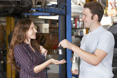 Satisfied Customer Collecting Car From Garage Mechanic Stock Image